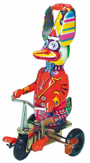 Blechspielzeug Ente auf Dreirad.